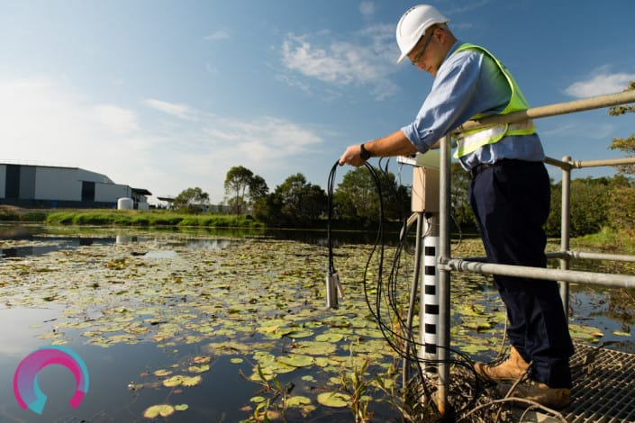 Man using water testing device to test water quality at Brisbane Airport, Queensland