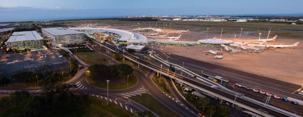 View of the domestic terminal and car parking at Brisbane Airport, at dusk, shot from the Air Traffic Control Tower