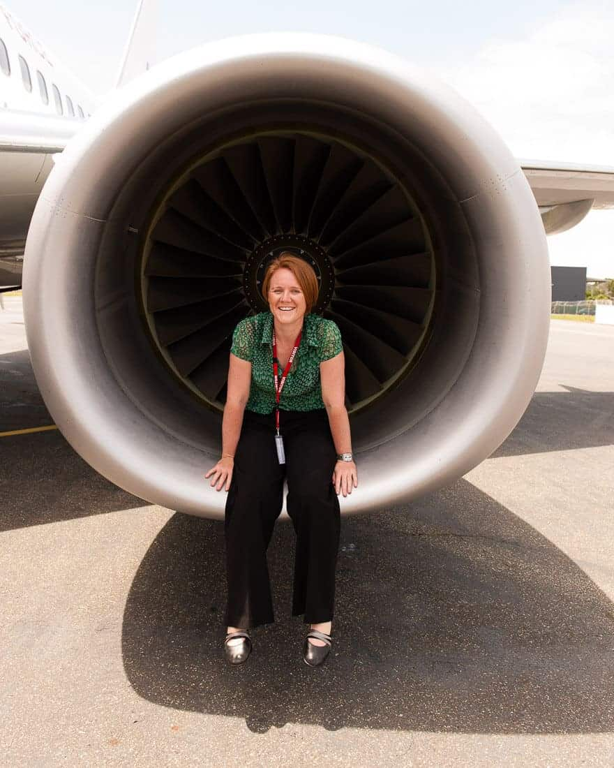 Portrait of Jen Dainer, Commercial, Industrial, Aviation Photographer and Video Producer, Brisbane. Sitting inside a jet engine