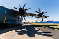 Image of the wing of a RAF A400M, showing two propellers.